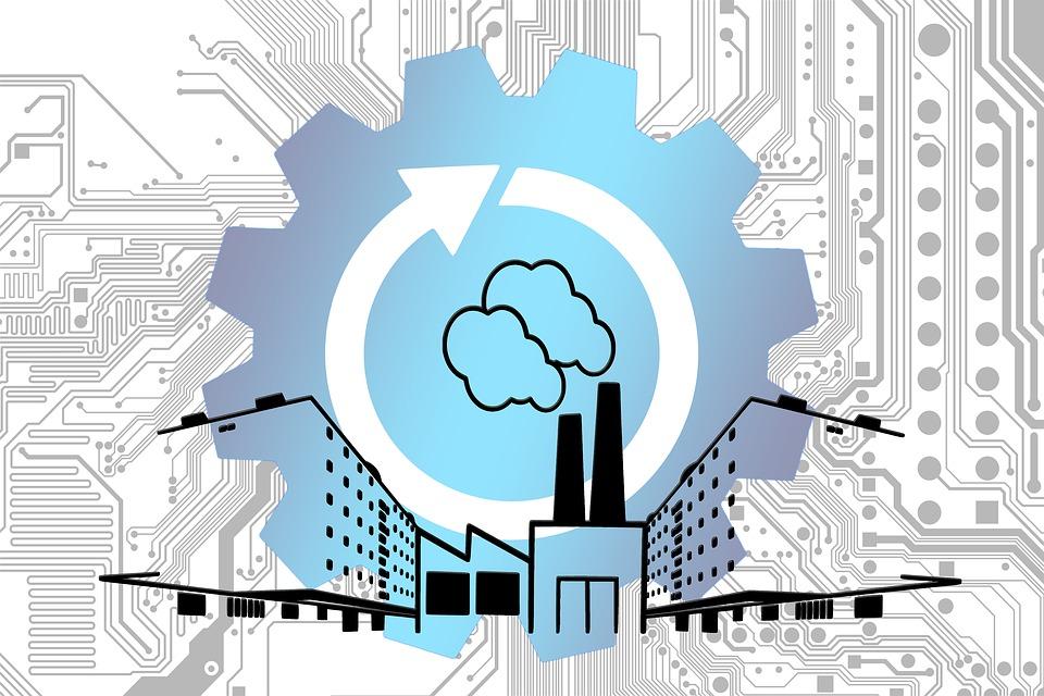 Internet of things - Bild mit einem großen Zahnrad und eine Abbildung einer Fabrik mit Schornsteinen.
